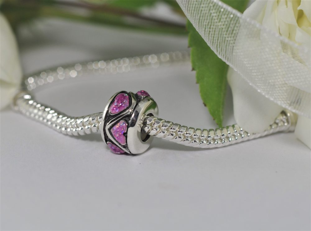 Pink stopper charm